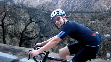 Kevin Johnson riding a bike.